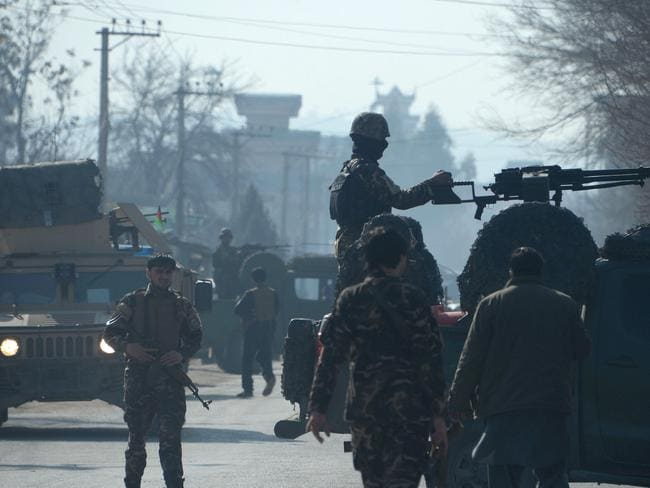Afghanistan remains a country on the edge, with an estimated 16,000 soldiers or police killed or wounded during 2015. In this picture, security personnel keep watch at the site of a suicide bombing at the home of a prominent politician in Jalalabad on January 17. At least 13 people were killed. Picture: AFP/Noorullah Shirzada