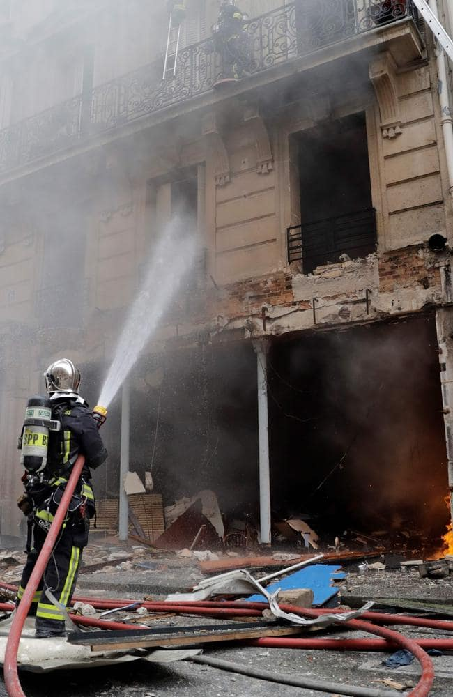 Firefighters extinguish a fire after the explosion of a bakery in Paris. Picture: AFP
