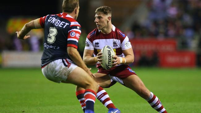 George Williams in action for Wigan against the Roosters.
