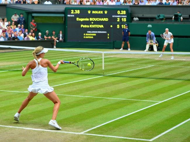 Canada's Eugenie Bouchard returns a forehand against Czech Republic's Petra Kvitova.