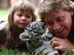 Steve Irwin and his daughter Bindi Irwin with a six-week-old Bengal tiger cub at Australia Zoo. (AAP Image/Tony Phillips)