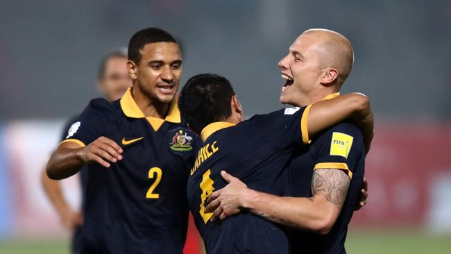 Meredith (L) in action for the Socceroos in 2015.
