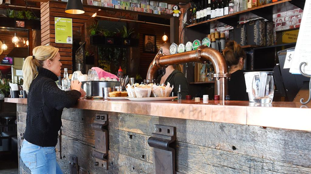 Communal cutlery trays, water and menus at the bar could be a thing of the past. Picture: Josie Hayden