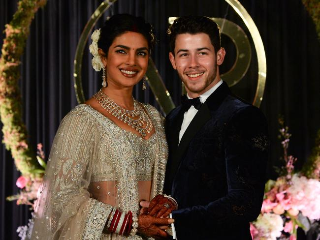 Indian Bollywood actress Priyanka Chopra (L) and US musician Nick Jonas, who were recently married, pose for a photograph during a reception in New Delhi on December 4, 2018. Picture: Sajjad Hussain/AFP
