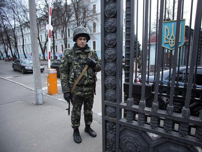 For the defence ... A soldier stands guard at the Ukrainian Defence Ministry in Kiev. Picture: UKRAINIAN PRESIDENTIAL PRESS SERVICE