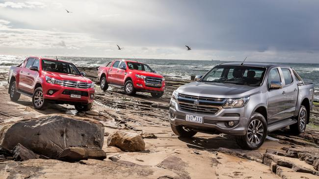 See change ... Aussies are buying utes such as the Toyota HiLux (left), Ford Ranger (centre) and Holden Colorado (right) in record numbers. Picture: Thomas Wielecki.