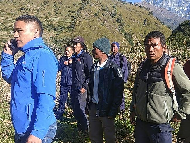 Members of the Nepali rescue team look on during the rescue operations for the bodies of nine climbers killed at Mount Gurja. Picture: AFP