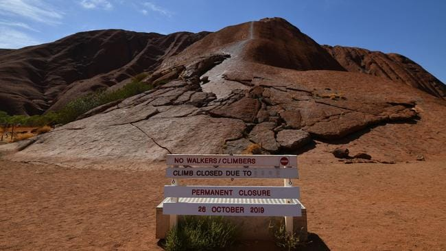A notice for a permanent ban on climbing Uluru is seen at Uluru-Kata Tjuta National Park in Australia's Northern Territory on October 26, 2019. Picture: Saeed KHAN / AFP.