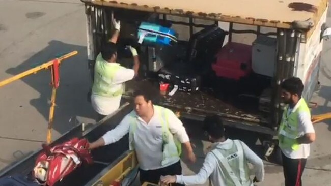 The workers could be seen tossing the bags into the cart. Picture: Marcela Fernanda Solis Walker