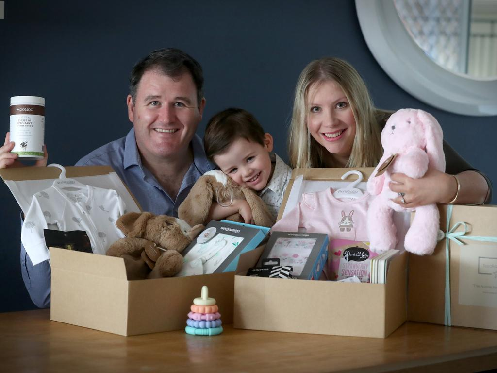 Hayley Stephens and her brother-in-law Rob Fagan have and Rob's son Carter test their Australian brands baby hampers. Picture: Jamie Hanson