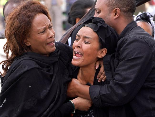 Mourners, believed to be family members of a victim on-board the aircraft, visit the crash site of Ethiopian Airlines Flight ET302 on March 14, 2019 in Ejere, Ethiopia. Picture: Getty
