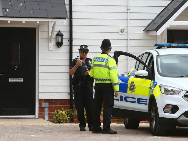 A police officer stands guard outside Charlie Rowley's house in Amesbury. Picture: AFP