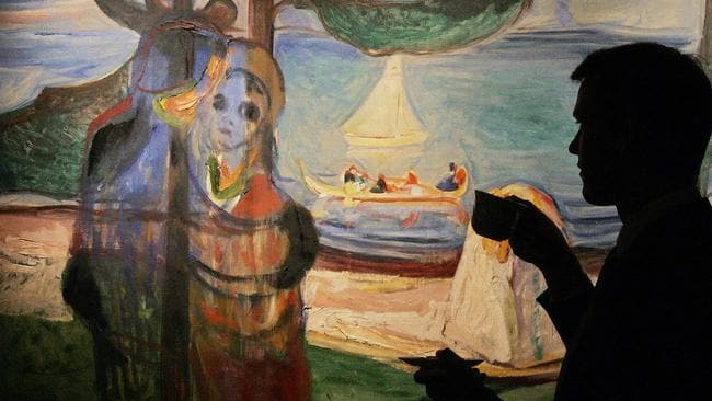 A man studies a painting entitled Summer Day by Norwegian artist Edvard Munch at the Sotheby's auction house in London.