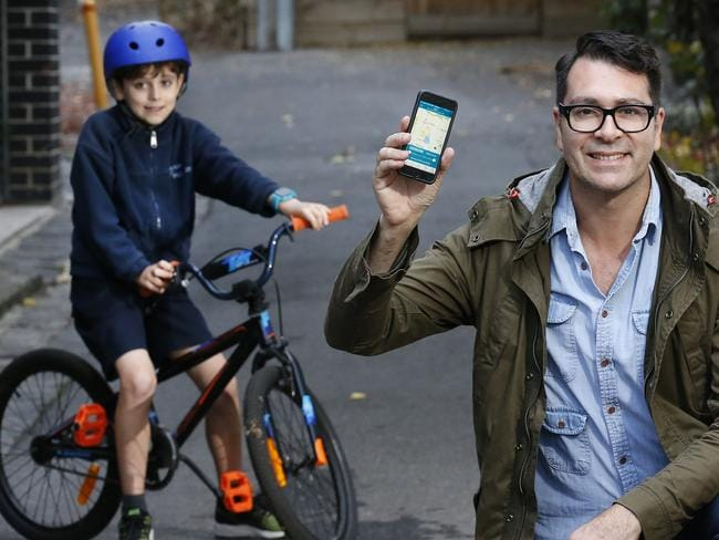 The whereabouts of a child wearing a Spacetalk watch can be tracked by parents via their mobile phone. Erz Imam can know exactly where his son Mavi is at any time using his smart phone. Picture: David Caird