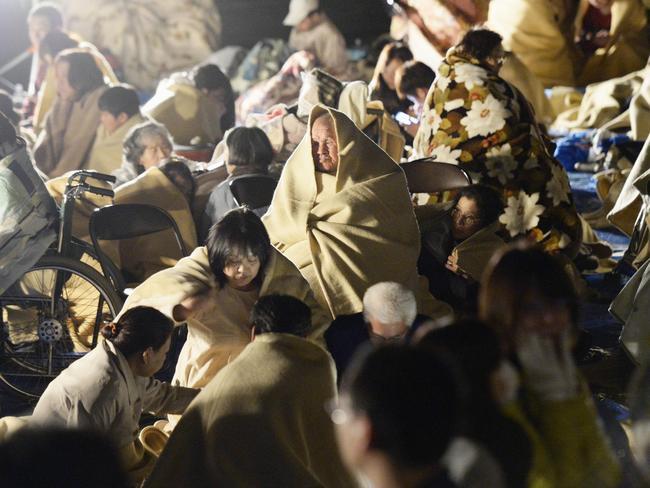 Residents take shelter outside the town hall of Mashiki, near Kumamoto city, southern Japan. Picture: Ryosuke Uematsu/Kyodo News.