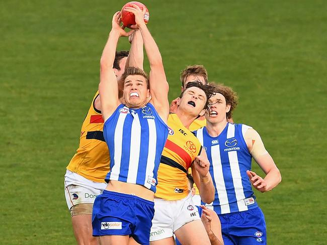 Mason Wood takes a pack mark against Adelaide.