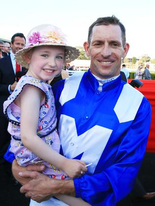 Hugh Bowman with daughter Bambi after another Winx blitz. Pictures: Getty Images, AAP