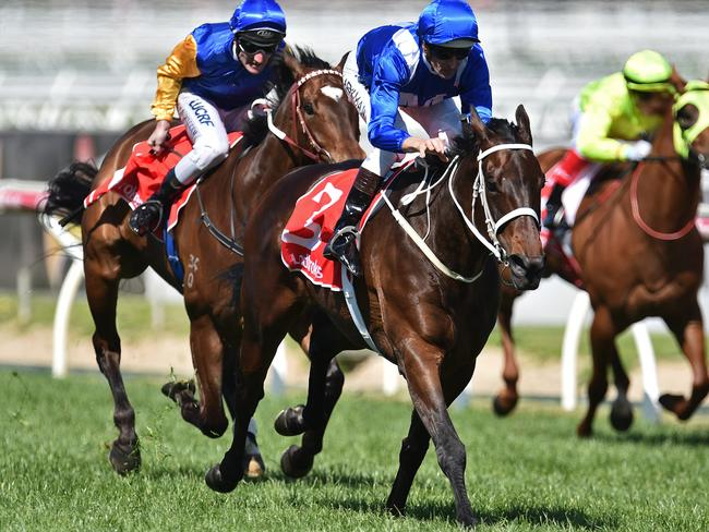 High Bowman rides Winx (centre) to victory in the Caulfield Stakes ahead of Black Heart Bart (left) and He Or She (right) in a three-horse race in 2016.