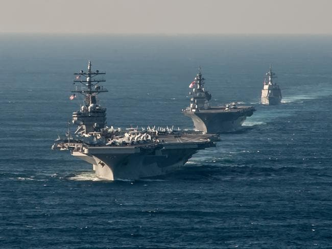 The US Navy's forward-deployed aircraft carrier USS Ronald Reagan (CVN 76) transits alongside Japan Maritime Self-Defense Force (JMSDF) Izumo-class helicopter destroyer JS Izumo (DDH 183) and JMSDF Akizuki-class destroyer JS Teruzuki (DD 116). Picture: USN