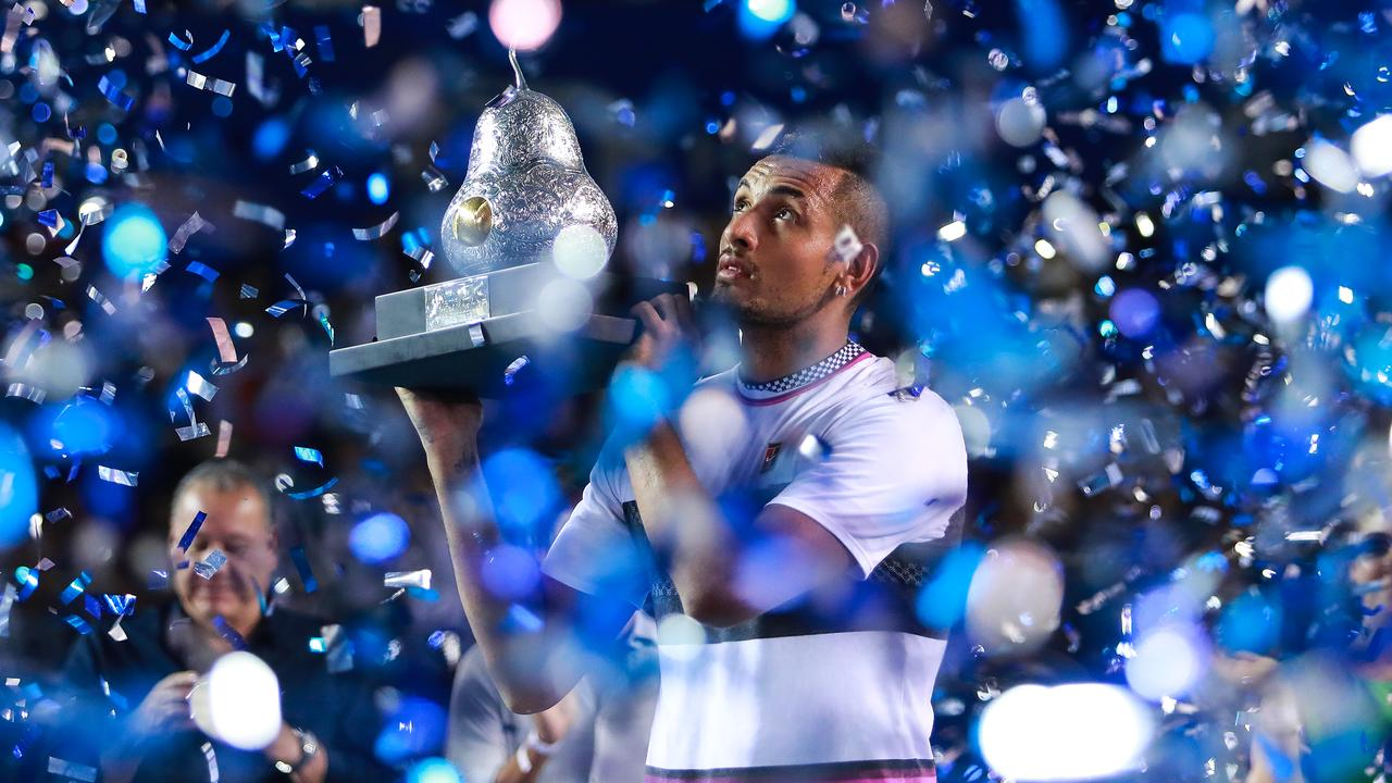 Another angle of Kyrgios with the pear trophy.