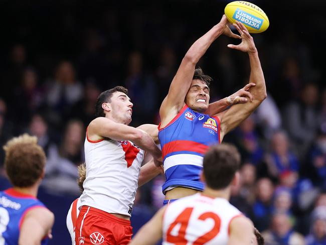 The Dogs couldn't get the win for top draft pick Jamarra Ugle-Hagan (R) in his first AFL game. Pic: Michael Klein