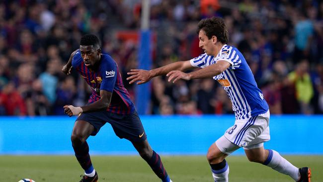 Barcelona's French forward Ousmane Dembele (L) challenges Real Sociedad's Spanish midfielder Mikel Oyarzabal