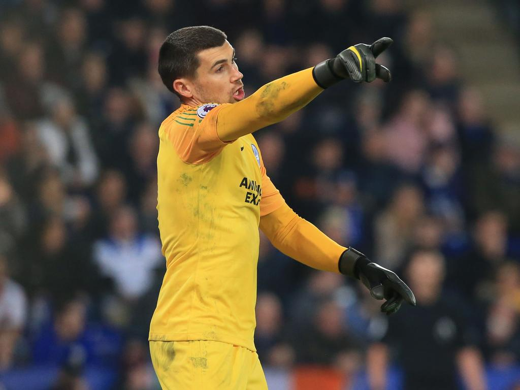 Brighton's Australian goalkeeper Mathew Ryan gestures during the English Premier League football match between Leicester City and Brighton and Hove Albion at King Power Stadium in Leicester, central England on February 26, 2019. (Photo by Lindsey PARNABY / AFP) / RESTRICTED TO EDITORIAL USE. No use with unauthorized audio, video, data, fixture lists, club/league logos or 'live' services. Online in-match use limited to 120 images. An additional 40 images may be used in extra time. No video emulation. Social media in-match use limited to 120 images. An additional 40 images may be used in extra time. No use in betting publications, games or single club/league/player publications. /