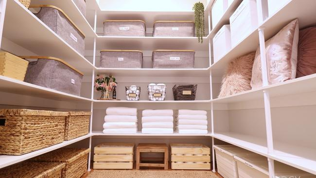 Nina's stunning linen cupboard uses all available space to store linen and bathroom supplies.