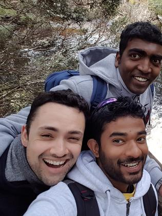 Chathura Silva, centre, with friends. Picture: Supplied