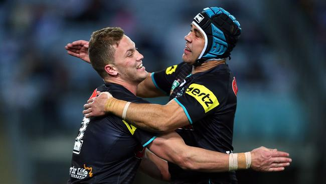 Matt Moylan of the Panthers celebrates his try with teammate Jamie Soward.