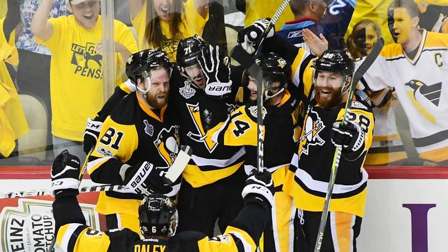 Evgeni Malkin #71 of the Pittsburgh Penguins celebrates with teammates after scoring a goal.