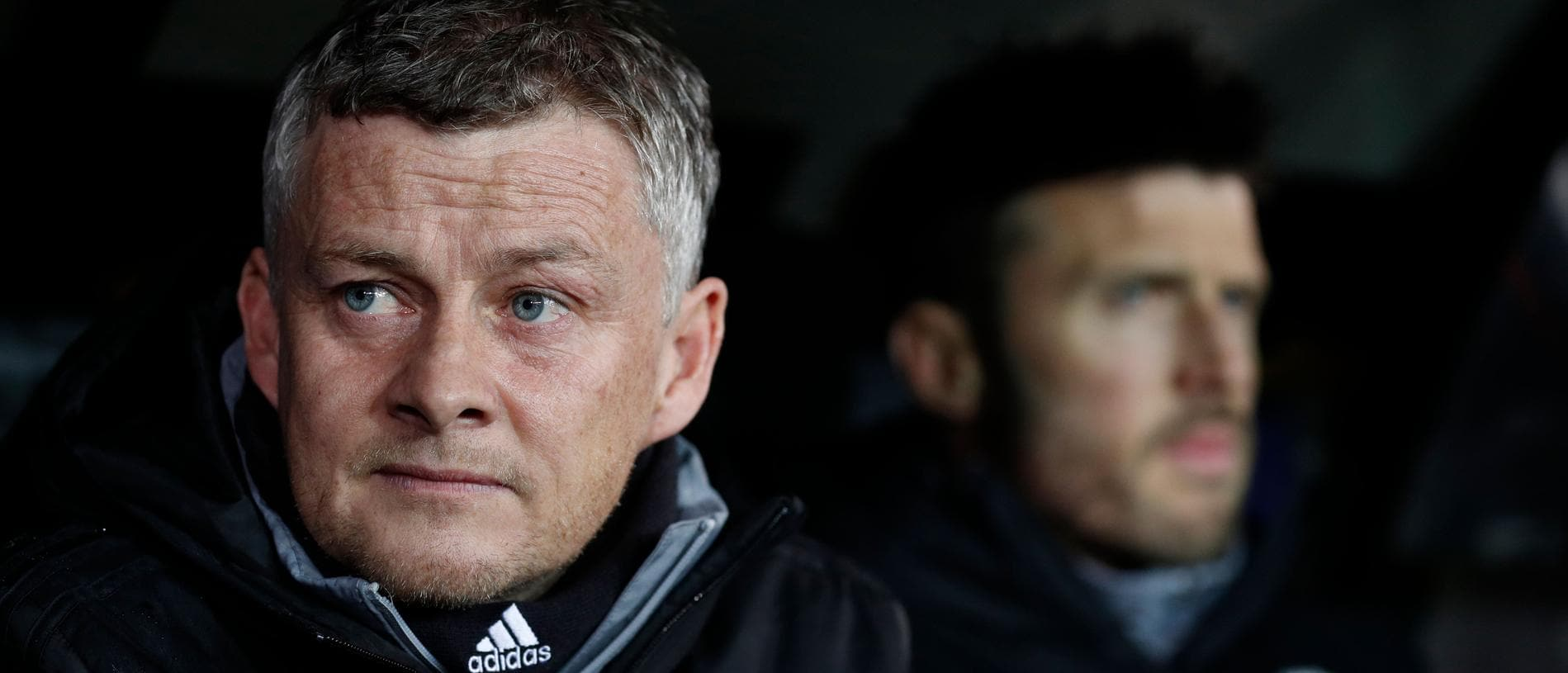 Manchester United's Norwegian manager Ole Gunnar Solskjaer (L)  looks on flanked by Manchester United's English first-team coach Michael Carrick, prior to the UEFA Europa League round of 32 first leg, football match between Club Brugge's and Manchester United, at the Jan Breydel Stadium in Bruges on February 20, 2020. (Photo by Adrian DENNIS / AFP)