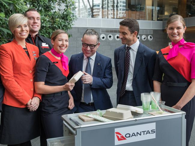 Alan Joyce and the 'Green Team' from Qantas and Jetstar show off the new alternative packaging passengers can expect to soon see on-board. Picture: Qantas