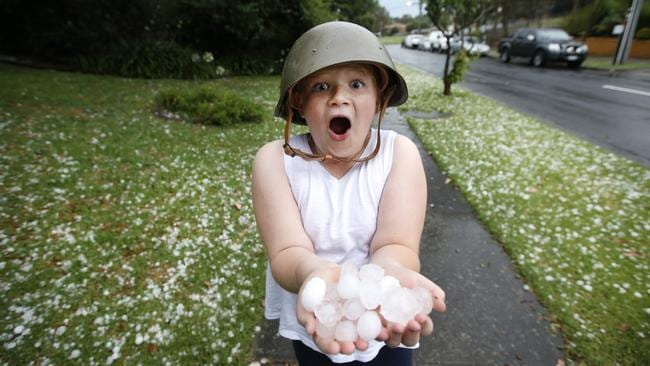 "Ella 8, with huge hailstorms in Templestowe. Ella said: ""I wished for a white Christmas, but not this."" Picture: David Caird"