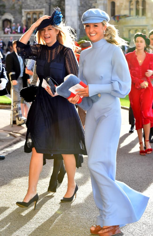 Chelsy Davy (left) and a Smurfette friend. Picture: Matt Crossick/PA Wire
