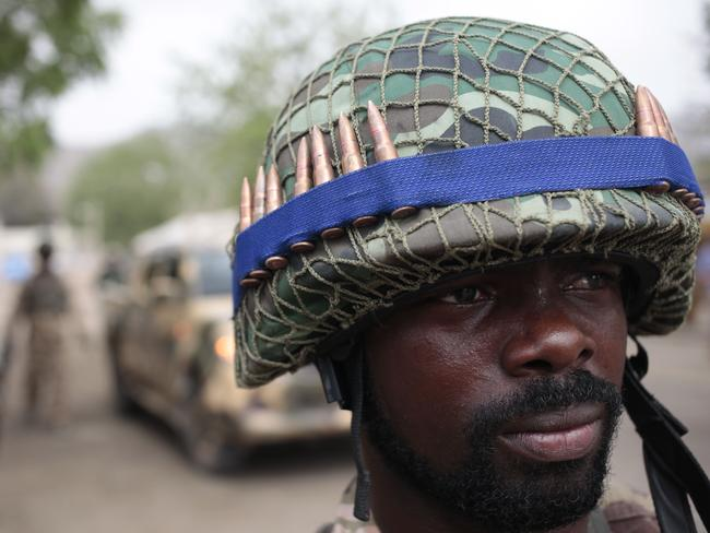 Making progress ... President Buhari has decorated soldiers in Yola for their bravery in the counter-insurgency against Boko Haram. Picture: AP/Lekan Oyekanmi