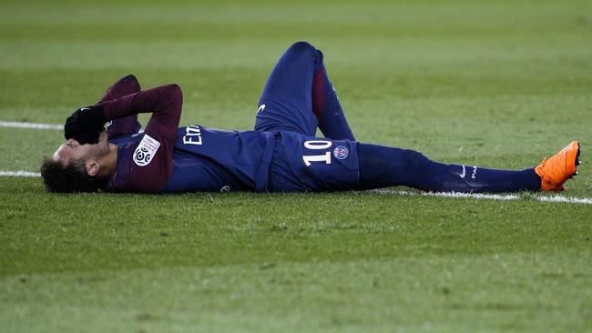Paris Saint-Germain's Brazilian forward Neymar Jr reacts after injuring himself