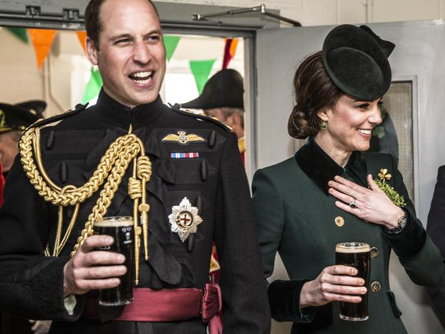 The Royals take a drink of Guinness as they meet with soldiers of the 1st battalion Irish Guards in their canteen following their St Patricks day parade at Cavalry Barracks. Picture: Getty.