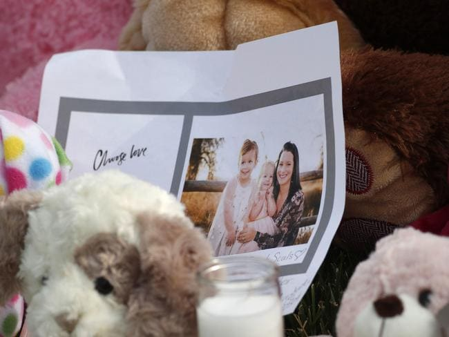 A photograph sits amid the tributes outside the home where pregnant woman, Shanann Watts, and her two daughters, Bella and Celeste, lived. Picture: AP