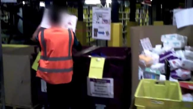 A worker loads expensive, unused items into bins. Picture: RTL.FR