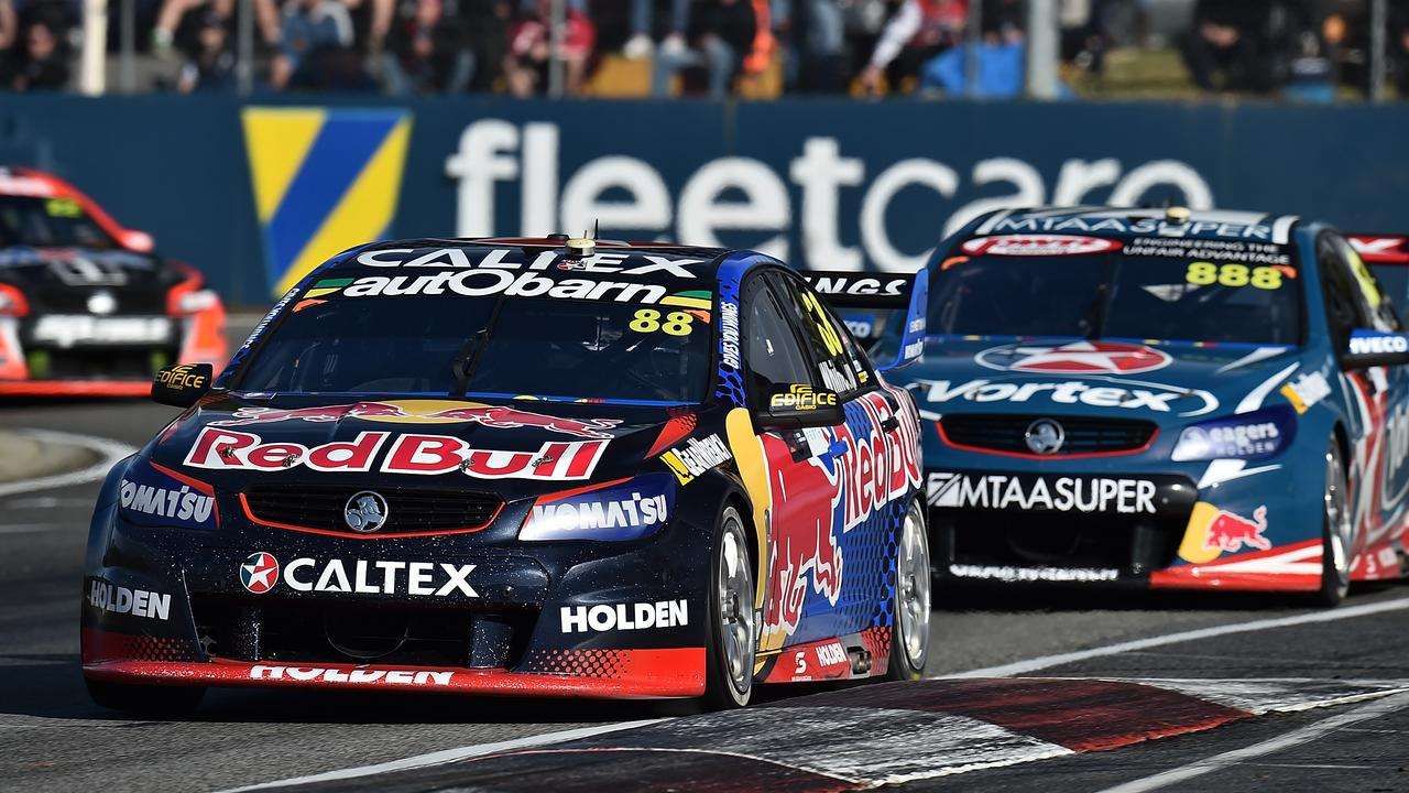 Craig Lowndes chases Jamie Whincup during his brilliant drive.