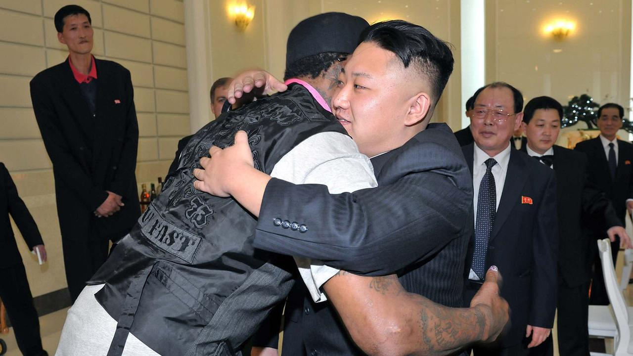 Kim Jong-Un hugs former NBA star Dennis Rodman. AFP PHOTO / KCNA