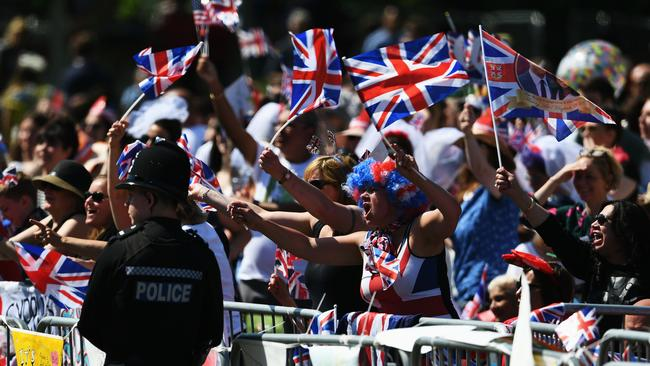 Joyful crowds gathered to celebrate the royal wedding in England. Picture: Jeff J Mitchell/Getty Images