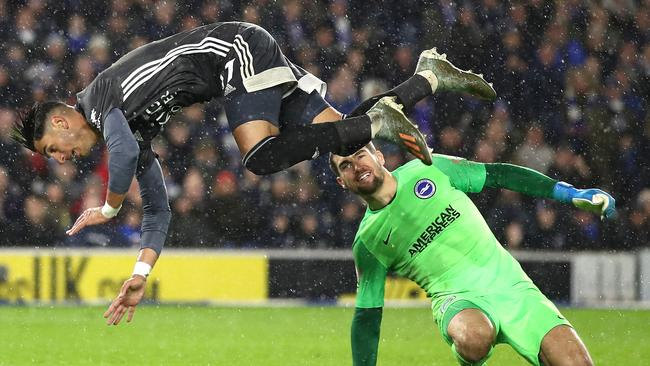 Ayoze Perez goes airborne after a tackle from Matt Ryan in Brighton's loss to Leicester City.