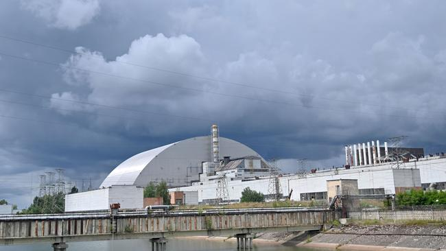Branded as the world's largest movable metal structure, the so-called New Safe Confinement seals the remains of the fourth reactor at the nuclear plant that was the site of the massive Chernobyl disaster in 1986. Picture: Sergei Supinsky/AFP