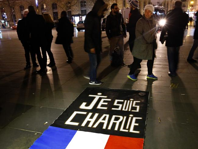 "In memory ... A ""Je suis Charlie"" banner on the Place de la Republique during a gathering that marks one year after the attacks on Charlie Hebdo satirical newspaper, in Paris. Picture: AP/Francois Mori"