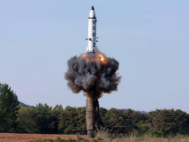 This undated picture released from North Korea's official Korean Central News Agency (KCNA) on May 22, 2017 shows North Korean ground-to-ground medium-to-long range strategic ballistic missile Pukguksong-2 being launched in a test-fire. Picture: AFP PHOTO/KCNA VIA KNS