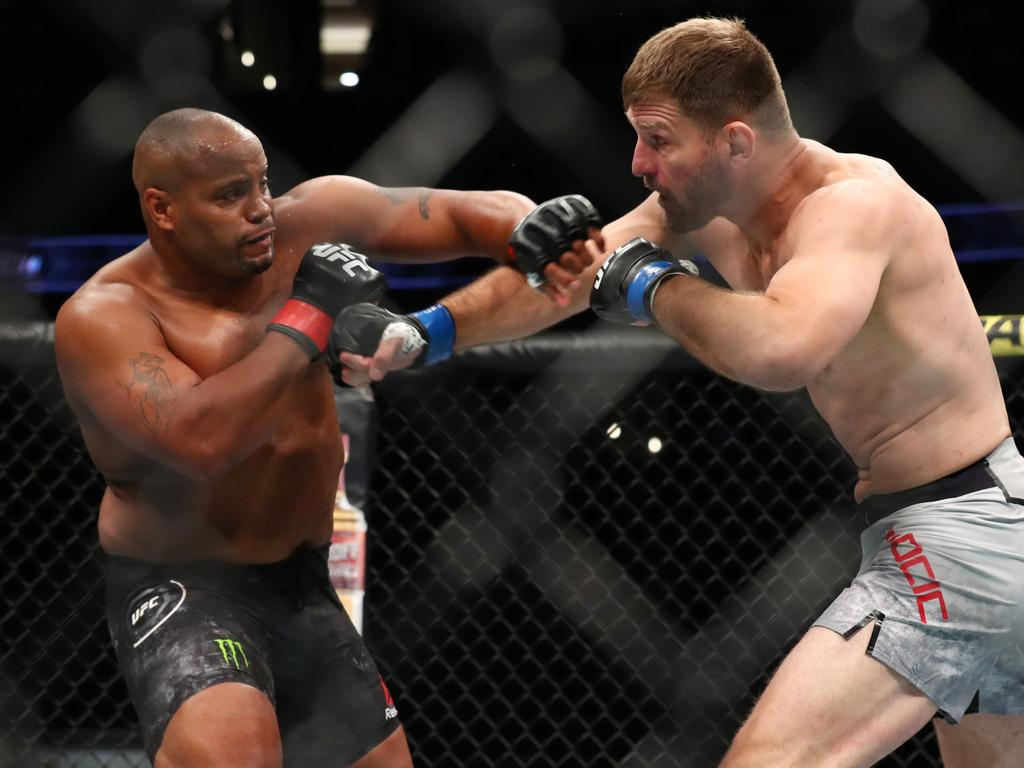 ANAHEIM, CALIFORNIA - AUGUST 17: Daniel Cormier throws a punch at Stipe Miocic in the first round during their UFC Heavyweight Title Bout at UFC 241 at Honda Center on August 17, 2019 in Anaheim, California. (Photo by Joe Scarnici/Getty Images)