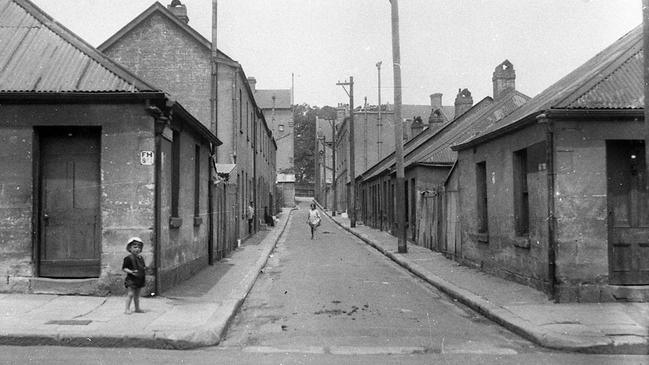 DIFFERENT ERA: A Surry Hills slum at nearby McElhone Place pictured in the early 20th century around the time the Bourke St home last sold. Picture: City of Sydney