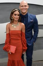Michael Klim and Desiree Deravi pose for a photograph in the birdcage on Melbourne Cup Day at Flemington Racecourse in Melbourne, on Tuesday, Nov. 1, 2016. Picture: AAP Image/Dan Himbrechts